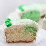 Green & White Cake - Slice with Cake behind