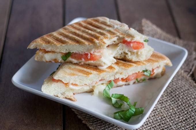 Bite taken from Caprese Sandwich