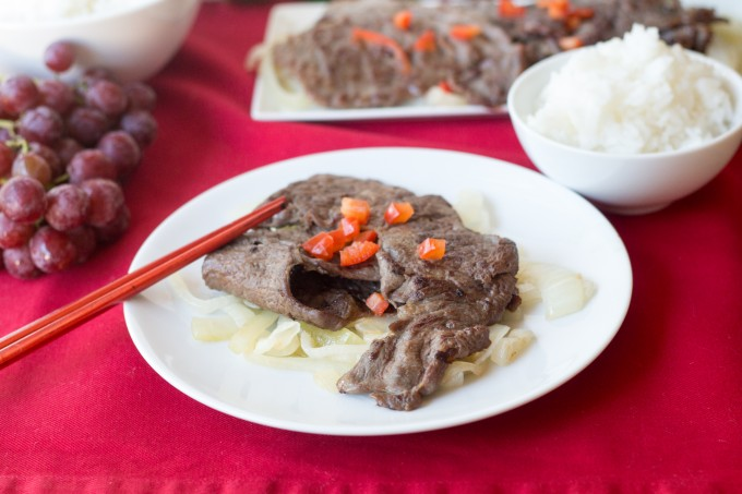 Chinese Steak served with onions and rice